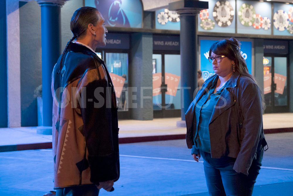 """RUTHERFORD FALLS -- """"Rutherford Inc."""" Episode 107 -- Pictured: (l-r) Michael Greyeyes as Terry Thomas, Jana Schmieding as Reagan Wells -- (Photo by: Colleen Hayes/Peacock)"""