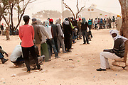 Merlin in Tunisia. Shousha camp for migrant workers displaced from Libya February to May 2011. Queuing for lunch.