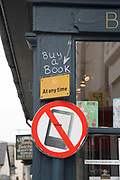 "Signs promotong a ban on Kindles at Hay-on-Wye or Y Gelli Gandryll in Welsh, known as ""the town of books"", is a small town in Powys, Wales famous for it's many second hand and specialist bookshops, although the number has declined sharply in recent years, many becoming general antique shops and similar."