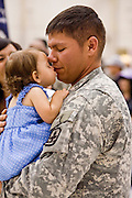 "30 MARCH 2008 -- PHOENIX, AZ: HOPE SALINAS greets her father, PAUL SALINAS, an Arizona National Guard soldier, after he came home Sunday from a year long deployment to Afghanistan. About 250 members of the Arizona Army National Guard's 158th Infantry Battalion returned to Phoenix, AZ, from a year long deployment in Afghanistan Sunday. The unit, also known as the ""Bushmasters"" from their service in World War II, was part of the largest single-unit deployment of the Arizona National Guard since the second World War. Two members of the battalion were killed in action during their deployment. The battalion, a combat unit, engaged in counter insurgency operations through out their deployment. Photo by Jack Kurtz / ZUMA Press"