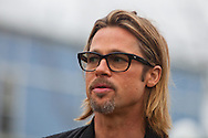 """Brad Pitt on a walking tour through the """" Make it Right """" houses in New Orleans Lower 9th Ward the day before a star-studded gala being held in New Orleans."""
