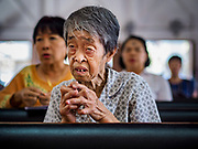 06 MARCH 2019 - BANGKOK, THAILAND: An elderly woman prays the rosary on Ash Wednesday at Holy Redeemer Catholic Church in Bangkok. There are about 300,000 Catholics in Thailand in about 430 Catholic parishes and about 660 Catholic priests in Thailand. Thais are tolerant of other religions and although Thailand is officially Buddhist, Catholics are allowed to freely practice and people who convert to Catholicism are not discriminated against.    PHOTO BY JACK KURTZ