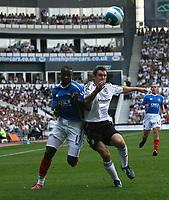 Photo: Steve Bond. <br />Derby County v Portsmouth. Barclays Premiership. 11/08/2007. John Utaka (L) and Andy Griffin (R) tussle