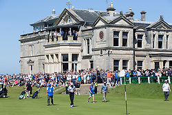 Former US president Barack Obama playing the 18th green at St Andrews.