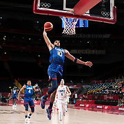 TOKYO, JAPAN - JULY 25:   Jayson Tatum #10 of the United States slam dunks during the USA V France basketball preliminary round match at the Saitama Super Arena at the Tokyo 2020 Summer Olympic Games on July 25, 2021 in Tokyo, Japan. (Photo by Tim Clayton/Corbis via Getty Images)