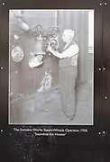 Public display of old historic images about the GWR works, Swindon, Wiltshire, England, UK steam whistle operator 'Sounding the Hooter'