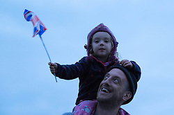 © Licensed to London News Pictures.22/08/15<br /> Castle Howard, North Yorkshire, UK. <br /> <br /> ELLA KITTON, 3, from York sits on her father MATT's shoulders to watch a performance during the 25th anniversary of the Castle Howard Proms event near York. The theme of the event this year is a commemoration of the 75th anniversary of the Battle of Britain and the 70th anniversary of VE day and brings an evening of classic musical favourites celebrating Britishness to the lawns of Castle Howard.<br /> <br /> Photo credit : Ian Forsyth/LNP