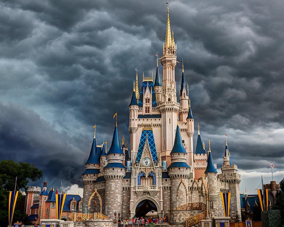 A storm arrives at Cinderella's Castle, Walt Disney World, Florida