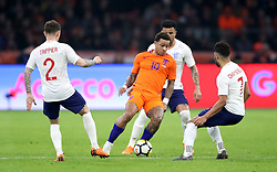 Netherlands' Memphis Depay (centre) in action during the international friendly match at the Amsterdam ArenA.