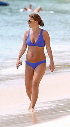 EXCLUSIVE: Coleen Rooney spotted taking a stroll on the beach in Barbados as her former England captain husband Wayne contemplates a move to Washington. 22 May 2018 Pictured: Coleen Rooney. Photo credit: Vantage News/MEGA TheMegaAgency.com +1 888 505 6342