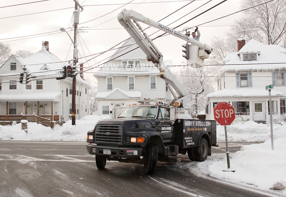 Middletown, New York - A worker from Harry F. Rotolo & Son Electrical Contractors tries to fix a traffic light at an intersection after about two feet of snow fell during a storm on Feb. 26, 2010.