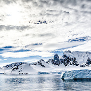A landscape shot of some of the rugged mountains of the Antarctic Peninsula of Cuverville Island.