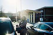 """SELMA, AL – DECEMBER 19, 2019: Keshee Dozier-Smith, 34, leaves the Selma-Dallas County YMCA after a board meeting. Dozier-Smith took her seat on the Selma-Dallas County YMCA Board of Directors in September, 2019, and views her involvement there as an opportunity to encourage overall fitness and wellness within the community, and within the Rural Health Medical Program network. """"It's really part of our broader mission at Rural Health Medical Program – helping our patients connect with the community through health, fitness and wellness, and to bring people from different walks of life together."""".<br /> <br /> Since joining Rural Health Medical Program as Chief Executive Officer in March 2016, Dozier-Smith has effectively moderned the 35-year-old floundering business – opening three new clinics, streamlining processes and reaching out to local companies to offer healthcare services for employees. In the wake of rising hospital closures that leave Alabama's poorest citizens disproportionately cut off from access to medical care, Dozier-Smith represents a renewed effort to bridge the rural gap by offering a quality, affordable healthcare option."""