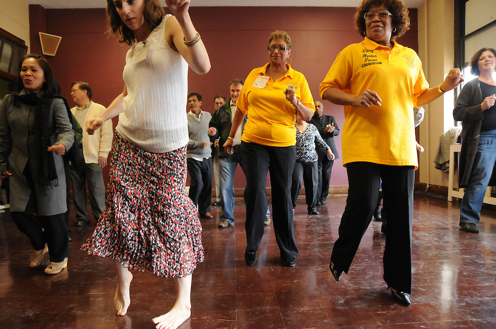St. Eulalia Catholic Church parishioners help to christen the Cesar Chavez Performing Arts Studio with a line dance during an open house of the newly-inaugurated Quinn Community Center in Maywood. The former home of the parish school had been underutilized for several years until Pastor Carmelo Mendez initiated a revitilization of the building, re-naming it in honor of former St. Eulalia Pastor William Quinn. Quinn made a lasting history for himself as a pioneer for social justice, both in the fields of civil rights, along with those of immigrants.