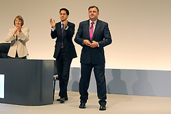 © Licensed to London News Pictures. 26/09/2011. LONDON, UK. (L-R) Harriet Harman and Ed Miliband applaud Ed Balls after he successfully delivers his speech at The Labour Party Conference in Liverpool today (26/09/11). Photo credit:  Stephen Simpson/LNP