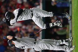 October 11, 2017 - Cleveland, OH, USA - The New York Yankees' Gary Sanchez, left, celebrates with Didi Gregorius after his solo home run against the Cleveland Indians in the first inning during Game 5 of the American League Division Series, Wenesday, Oct. 11, 2017, at Progressive Field in Cleveland. (Credit Image: © Phil Masturzo/TNS via ZUMA Wire)