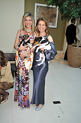 Left to right, LISA TCHENGUIZ and her dog George and POLLY SHALSON at the annual Dog's Trust Honours Awards held at The Hurlingham Club, Fulham, London on 19th May 2009.