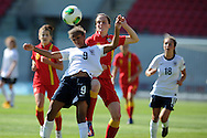 England's goalscorer Nikita Parris (9) holds off Alys Hinchcliffe of Wales. UEFA Womens U19 Championships 2013 match, Wales v England at Parc y Scarlets in Llanelli on Thursday 22nd August 2013. pic by Andrew Orchard ,Andrew Orchard sports photography,