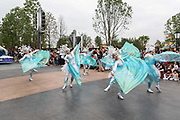 Dancers perform in a parade at Walt Disney Co.s Shanghai Disneyland theme park  towards the iconic castle during a trial run ahead of its official opening, in Shanghai, China, on Wednesday, June 8, 2016. The $5.5 billion Shanghai Disneyland is one  of the most profitable Disney ventures in the world and the first theme park on mainland China.