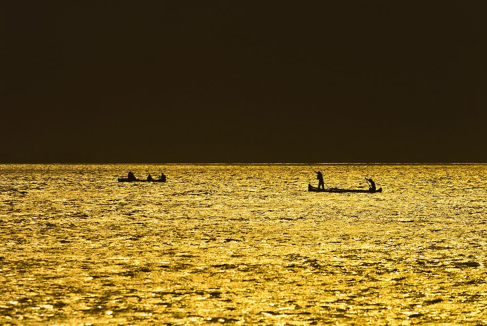 Kuna Indian men fishing in dugout canoes, San Blas Islands (Kuna Yala), Caribbean Sea, Panama