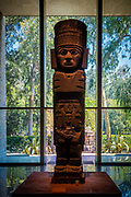 "The National Museum of Anthropology (Spanish: Museo Nacional de Antropología, MNA) is a national museum of Mexico. It is the largest and most visited museum in Mexico. Located in the area between Paseo de la Reforma and Mahatma Gandhi Street within Chapultepec Park in Mexico City, the museum contains significant archaeological and anthropological artifacts from the Mexico's pre-Columbian heritage, such as the Stone of the Sun (or the Aztec calendar stone) and the 16th-century Aztec Xochipilli statue. Designed in 1964 by Pedro Ramírez Vázquez, Jorge Campuzano, and Rafael Mijares Alcérreca, the monumental building contains exhibition halls surrounding a courtyard with a huge pond and a vast square concrete umbrella supported by a single slender pillar (known as ""el paraguas"", Spanish for ""the umbrella""). The halls are ringed by gardens, many of which contain outdoor exhibits. The museum has 23 rooms for exhibits and covers an area of 79,700 square meters (almost 8 hectares) or 857,890 square feet (almost 20 acres)."