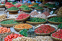 Baskets of fresh, colourful produce available for sale in a local market in the old quarter of Hanoi.