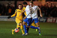 Christian Jolley of Newport (l) goes past Braintree's James Mulley. FA cup with Budweiser, 1st round replay, Newport county v Braintree Town at Rodney Parade in Newport, South Wales on Tuesday 19th November 2013. pic by Andrew Orchard, Andrew Orchard sports photography,