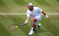 Paolo Lorenzi in action on day three of the Wimbledon Championships at the All England Lawn Tennis and Croquet Club, Wimbledon.