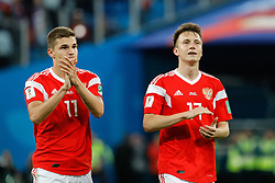 June 19, 2018 - Saint Petersburg, Russia - Roman Zobnin (L) and Aleksandr Golovin of Russia national team celebrate victory during the 2018 FIFA World Cup Russia group A match between Russia and Egypt on June 19, 2018 at Saint Petersburg Stadium in Saint Petersburg, Russia. (Credit Image: © Mike Kireev/NurPhoto via ZUMA Press)