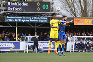 AFC Wimbledon defender George Francomb (7) battles for possession with Oxford United defender Ashley Smith-Brown (29) during the EFL Sky Bet League 1 match between AFC Wimbledon and Oxford United at the Cherry Red Records Stadium, Kingston, England on 10 March 2018. Picture by Matthew Redman.