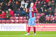 Lee Novak of Scunthorpe United (17) scores a goal and celebrates to make the score 2-3. during the EFL Sky Bet League 1 match between Scunthorpe United and Bradford City at Glanford Park, Scunthorpe, England on 27 April 2019.