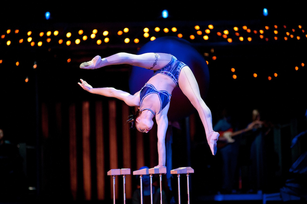 London, UK - 4 Janaury 2014: the Hand balancing act by Anna Ostapenko on stage the Aerial Hoops act during the dress rehearsal of Quidam at the Royal Albert Hall. (available only for editorial coverage of the Production)