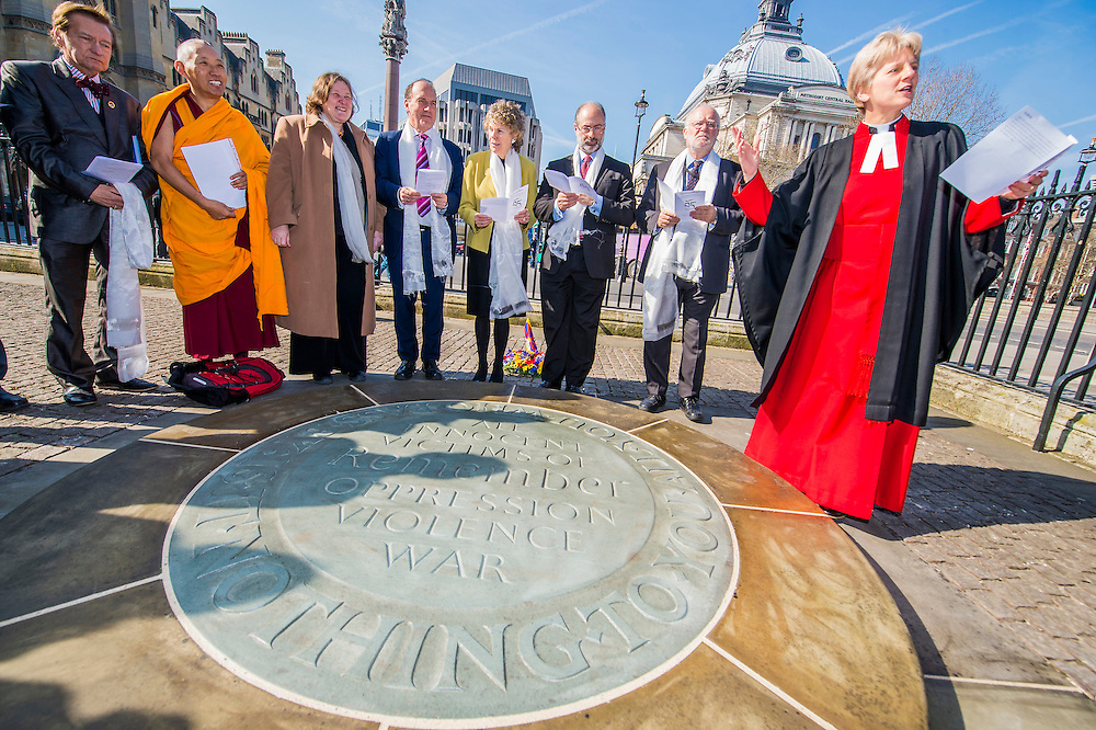 A wreath is laid  at The Memorial for Innocent Victims of war and oppression by Simon Hughes MP, Kate Hoey MP, Fabian Hamilton MP, and Lord Howarth (centre group from L to R) following a short multi-faith service led by Canon Jane Hedges (Right) from Westminster Abbey. MPs from the All Party Parliamentary Group for Tibet attended the annual ceremony in memory of Tibetans who have lost their lives since the Uprising in 1959. Westminster Abbey, London, UK 12 March 2014. Guy Bell, 07771 786236, guy@gbphotos.com