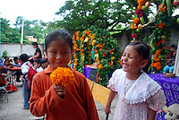 """MEXICO, Veracruz, Tantoyuca, Oct 27- Nov 4, 2009. Children at Tantoyuca's Roberto Medellin primary school laugh on their final official day before """"Xantolo."""" """"Xantolo,"""" the Nahuatl word for """"Santos,"""" or holy, marks a week-long period during which the whole Huasteca region of northern Veracruz state prepares for """"Dia de los Muertos,"""" the Day of the Dead. For children on the nights of October 31st and adults on November 1st, there is costumed dancing in the streets, and a carnival atmosphere, while Mexican families also honor the yearly return of the souls of their relatives at home and in the graveyards, with flower-bedecked altars and the foods their loved ones preferred in life. Photographs for HOY by Jay Dunn."""