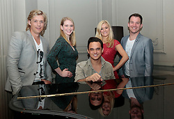 """© Licensed to London News Pictures. 16/07/2012. London, England. L-R: Jonathan Ansell, Emma Williams, Gareth Gates, Rachael Wooding, Daniel Boys. On Thursday, 19th July, Gareth Gates, Jonathan Ansell, Daniel Boys, Emma Williams and Rachael Wooding perform in """"Momentous Musicals"""", a brand new concert celebration showcasing ballads and songs from musicals for one night only at the New Wimbledon Theatre, London. The show is directed by John Garfield-Roberts with musical direction by John Dyer. Photo credit: Bettina Strenske/LNP"""