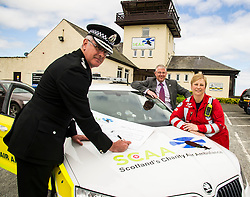 Pictured: Chief Constable Phil Gormley, Scottish Police Benevolent Fund seretary David Hamilton and SCAA Aircrew Paramedic Julia Barnes.<br /> <br /> The Scottish Police Benevolent Fund has donated £30,000 to help fund Scotland's Charity Air Ambulance (SCAA). Police Scotland Chief Constable Phil Gormley and Scottish Police Benevolent Fund secretary David Hamilton visited SCAA in Perth to thank them for their work. <br /> <br /> Ger Harley | EEm 16 May April 2016