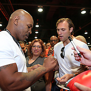 LAS VEGAS, NV - SEPTEMBER 13: Former champion Mike Tyson signs autographs for his fans during the Box Fan Expo at the Las Vegas Convention Center on September 13, 2014 in Las Vegas, Nevada.   (Photo by Alex Menendez/Getty Images) *** Local Caption ***Mike Tyson