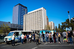 United States, Washington, Bellevue. Office workers line up to get lunch from food trucks in downtown Bellevue.