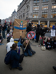 © under license to London News Pictures. 29/01/2011. Students take part in a sit in protest on Oxford Street, London during more student demonstrations today (29/01/2011). Thousands of students took to the streets of London and Manchester to protest against cuts to education. Photo credit should read: London News Pictures