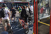 Mass of cycling commuters stopped at traffic lights at Kennington, south London.