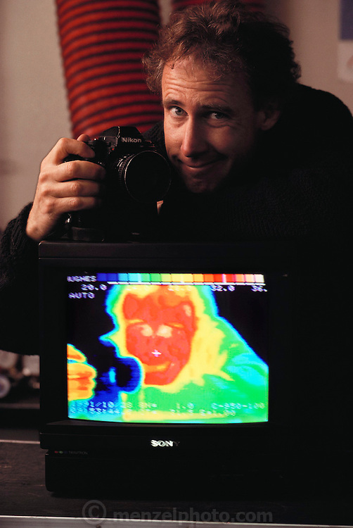 "Failure Analysis Associates, Inc. (an engineering and scientific consulting firm now called Exponent). Menlo Park, California. ""Probeye"" camera sees & measures thermal radiation: Peter Menzel, self-portrait with camera. MODEL RELEASED"