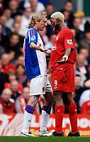 Photo: Glyn Thomas.<br />Liverpool v Blackburn Rovers. The Barclays Premiership.<br />15/10/2005.<br />Liverpool's Djibril Cisse (R) squares up to Robbie Savage.