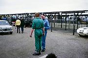 Bill de Selincourt, Whitsun Sports car race 3 June 1963, talking to mechanic,, Goodwood, England, UK