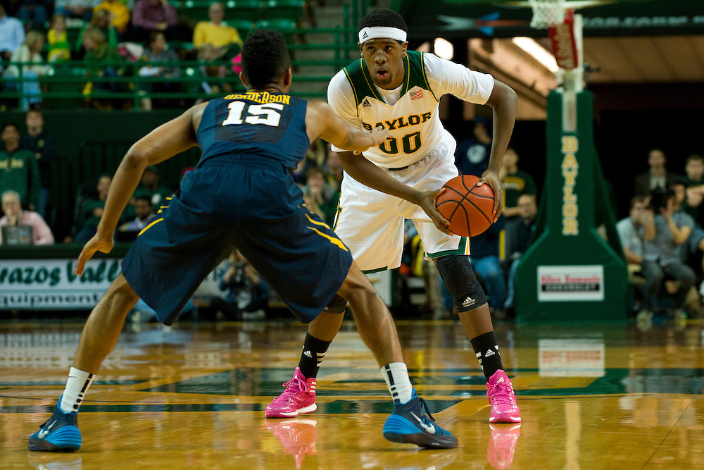 WACO, TX - JANUARY 28: Royce O'Neale #00 of the Baylor Bears brings the ball up court against the West Virginia Mountaineers on January 28, 2014 at the Ferrell Center in Waco, Texas.  (Photo by Cooper Neill/Getty Images) *** Local Caption *** Royce O'Neale