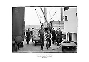 Dockers unloading a cargo of Kellog's Cornflakes at the North Wall, Dublin.<br /> <br /> 4th June 1954<br /> 04/06/1959