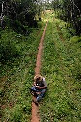 Dairen Simpson begins to set up traps near the village of Simana, Tanzania. Ami Vitale