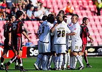 Photo: Leigh Quinnell.<br /> Bournemouth v Swansea City. Coca Cola League 1. 14/10/2007. Swansea players congratulate Ferrie Bodde after his goal.