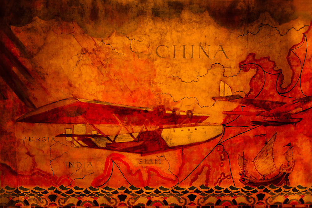"""This section of the sprawling """"Transport and Human Endeavor"""" mural by Edward Trumbull on the walls and ceiling of the Chrylser Building's main lobby  shows  then-contemporary """"flying boat"""" seaplanes soaring above the canvas sails of a traditional Chinese junk."""