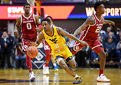 Feb 2, 2019; Morgantown, WV, USA; West Virginia Mountaineers guard Brandon Knapper (2) dribbles the ball late in the second half against the Oklahoma Sooners at WVU Coliseum. Mandatory Credit: Ben Queen-USA TODAY Sports