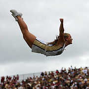 A UCF cheerleader flies through the air during an NCAA football game between the South Carolina Gamecocks and the Central Florida Knights at Bright House Networks Stadium on Saturday, September 28, 2013 in Orlando, Florida. (AP Photo/Alex Menendez)